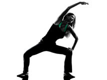 Woman dancer  stretching warming up exercises silhouette Stock Image