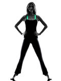 Woman dancer  stretching warming up exercises silhouette. One woman dancer stretching warming up exercises in studio silhouette isolated on white background Royalty Free Stock Image