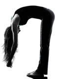 Woman dancer  stretching warming up exercises silhouette Royalty Free Stock Photography