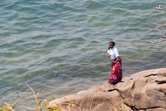 Woman dances at the beach at Lake Malawi. Stock Image