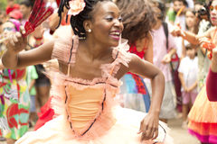 A woman dances dressed as a ballerina. NITEROI, BRAZIL - MAY 6, 2012. During a street party, celebrating the street band anniversary, a woman happily dances Royalty Free Stock Photography