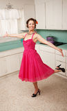Woman Dancing. Middle aged Caucasian woman dances in a kitchen Royalty Free Stock Photography