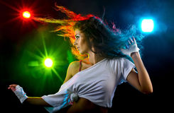 Woman dancing. Young woman dancing with disco lights royalty free stock image