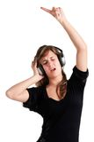 Woman Dancing. Using headphones isolated in a white background Stock Photos