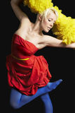Woman Dancing Against Black Background Royalty Free Stock Image