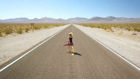 Woman dancing alone on street in the middle of nowhere. stock video footage