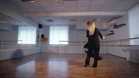 Woman dancing amateur dance in large light studio. Hobbies of ordinary housewife. Spinning in the dance. Window on the background stock video footage