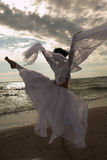 Woman dancing on the beach Stock Photography