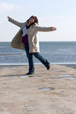 Woman Dancing at the Beach Stock Photos