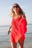 Woman dancing on the beach Stock Photo
