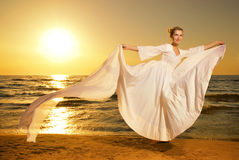 Woman dancing on a beach Royalty Free Stock Images