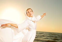 Woman dancing on a beach Stock Photography