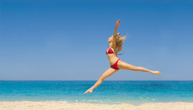Woman dancing on the beach Royalty Free Stock Photo