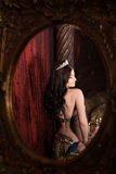 Woman dancing belly dance with shawl. Reflected in mirror. Aesthetic of East Stock Photography