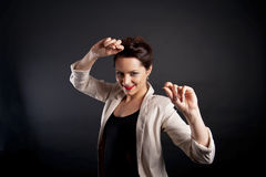 Woman dancing on blackbackground Stock Photos