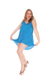 Woman dancing in blue dress. Royalty Free Stock Images