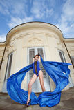 Woman dancing with blue fabric Stock Photography