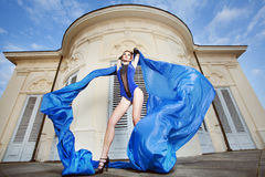 Woman dancing with blue fabric Royalty Free Stock Images