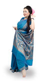 Woman dancing in blue sari Royalty Free Stock Photography