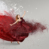 Woman dancing with cloud of powder Royalty Free Stock Images