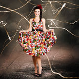 Woman dancing in colorful floral dress outdoor Stock Photos