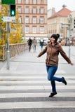 Woman dancing on the crosswalk Stock Images