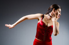 The woman dancing dances in red dress Stock Photos