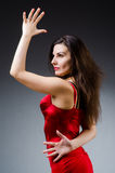 The woman dancing dances in red dress Stock Photography
