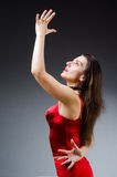 The woman dancing dances in red dress Stock Photo