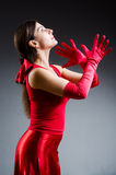 The woman dancing dances in red dress Royalty Free Stock Images
