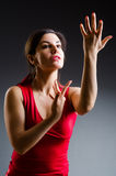 The woman dancing dances in red dress Royalty Free Stock Photos