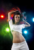 Woman dancing in disco. Attractive young woman dancing with colorful disco lights in background Stock Photography