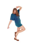 Woman dancing is dress. Stock Photography