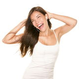 Woman dancing with earbuds / earphones royalty free stock photos