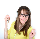 Woman dancing with earbuds / headphones listening to music on mp Royalty Free Stock Image