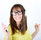 Woman dancing with earbuds / headphones listening to music on mp Royalty Free Stock Photo