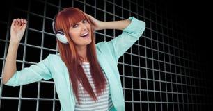 Woman dancing while enjoying music on headphones Royalty Free Stock Image