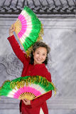Woman dancing with fan Stock Photography