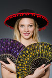 Woman dancing with fans Stock Image