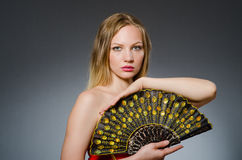 Woman dancing with fans Royalty Free Stock Photo