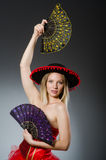 Woman dancing with fans Stock Photo