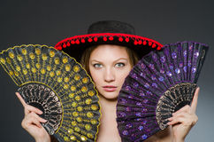 Woman dancing with fans Stock Photos