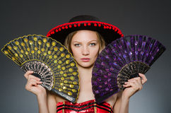 Woman dancing with fans Royalty Free Stock Image