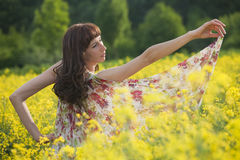 Woman dancing in field Stock Photography