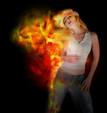 Woman Dancing with Fire on Black Royalty Free Stock Photos
