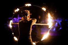 Woman dancing with fire stock photo