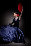 Woman dancing flamenco on black Stock Photography