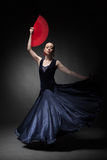Woman dancing flamenco on black Stock Image