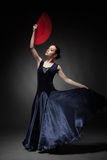 Woman dancing flamenco on black Stock Photos