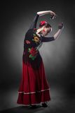 Woman dancing flamenco with castanets Royalty Free Stock Image